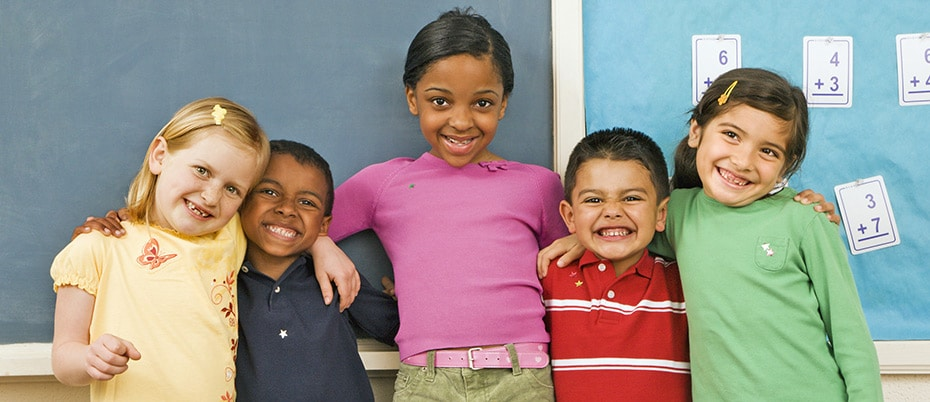 Five elementary students of different ethnic backgrounds