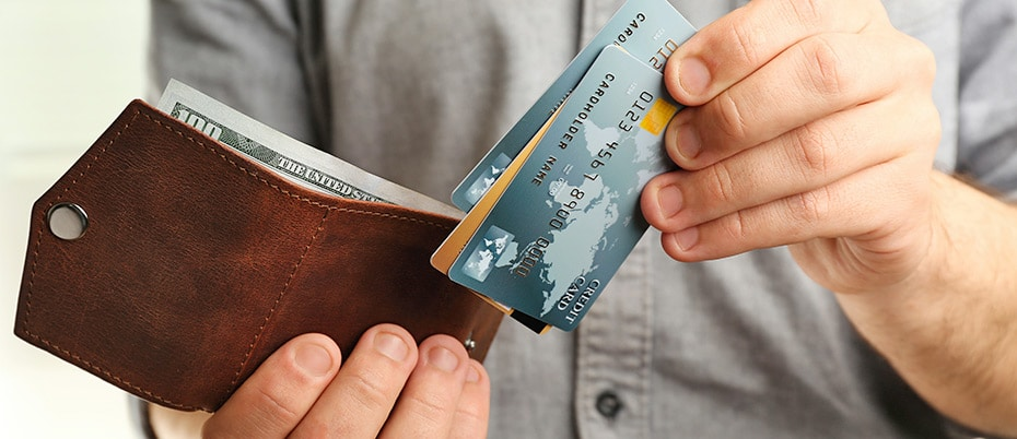 Man pulls cards out of wallet