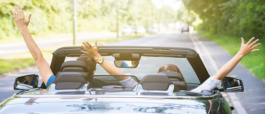 Happy couple in convertible on a nice day