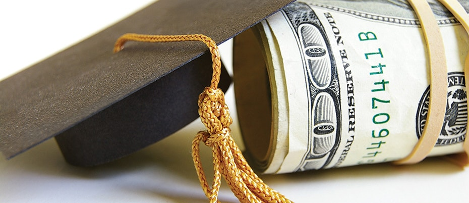 Mortar board and roll of money