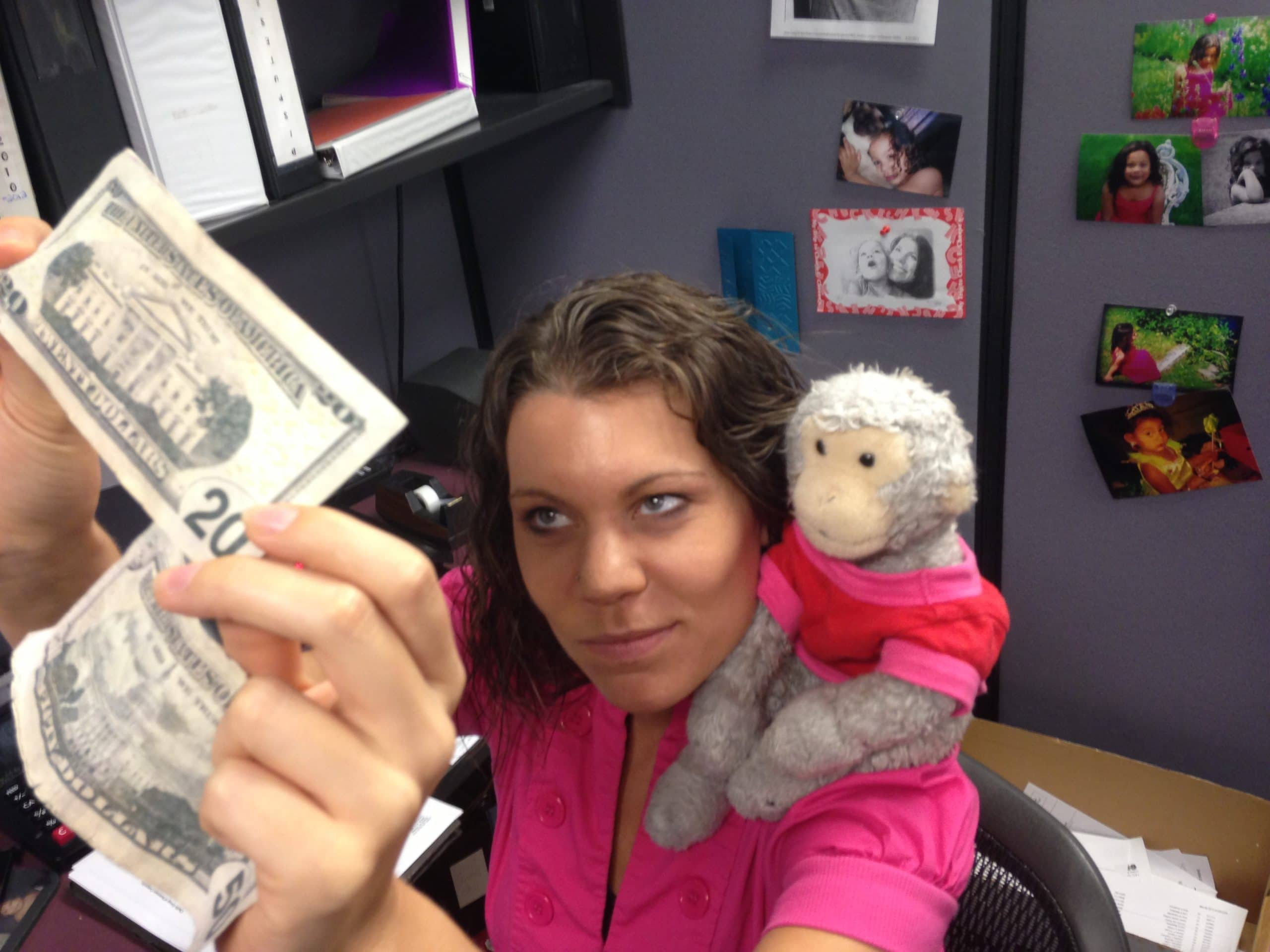 Our fraud specialist teaching the Monkey all about fake bills.