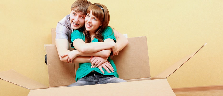 Couple hugging in moving box