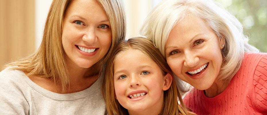 Grandma, mom and daughter smiling