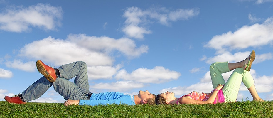 couple lying in grass dreaming