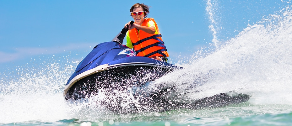 Young man having fun on a jet ski on a beautiful day