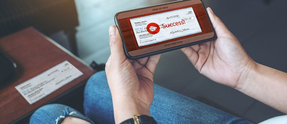 "Hands holding cell phone displaying image of check with ""Success!"" superimposed"