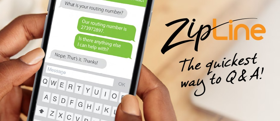 Hand holding mobile phone displaying a text conversation with ZipLine logo
