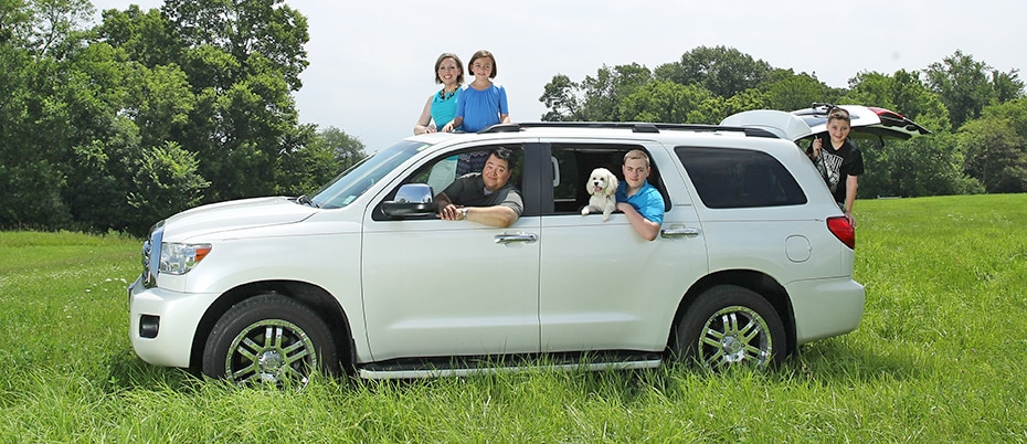 Family with dog in their new SUV
