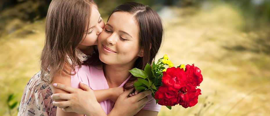Mom getting flowers and kiss from daughter