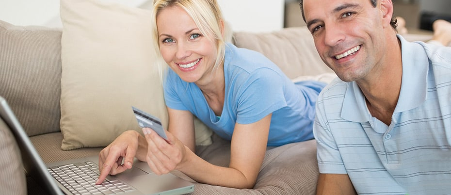 Mature couple making online purchase