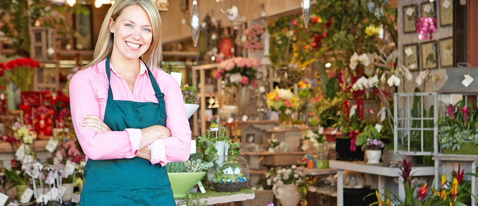 Florist smiling in front of shop