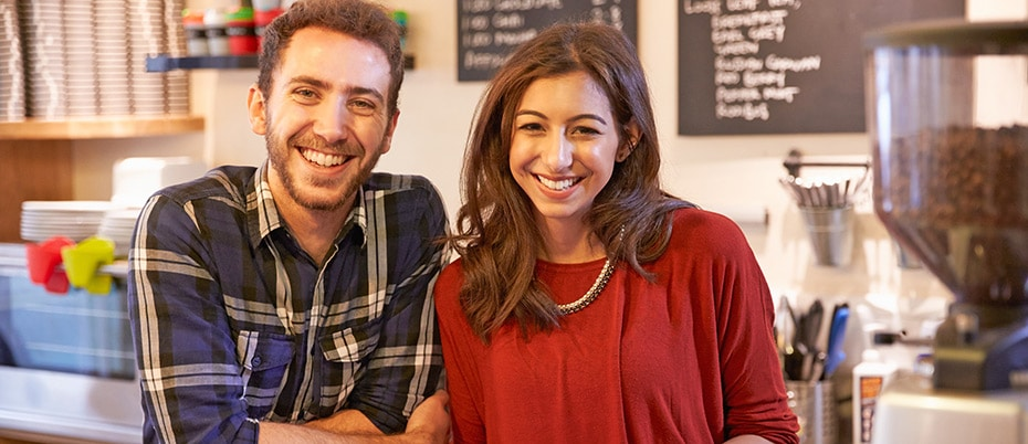 Smiling coffee shop owners