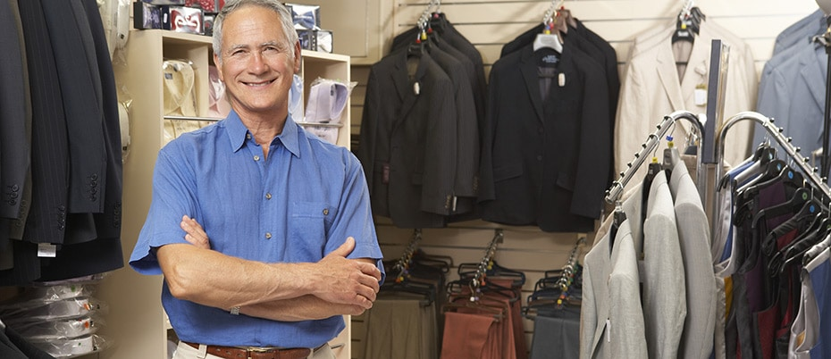 Smiling owner of men's clothing store
