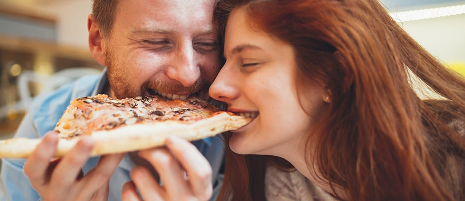 Couple sharing delicious pizza