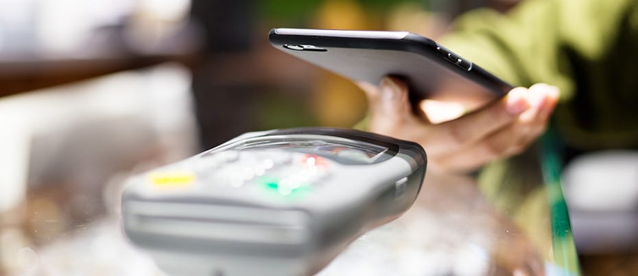 Retail woman paying with mobile phone