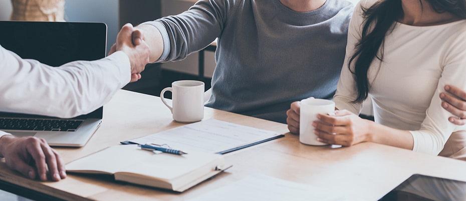 handshake across the desk