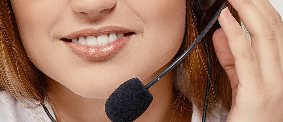 Close-up of smiling woman with headset