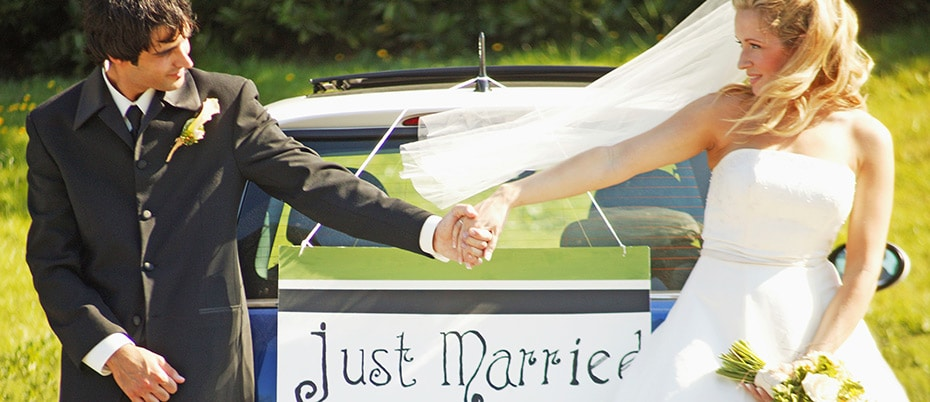 Just married couple holding hands