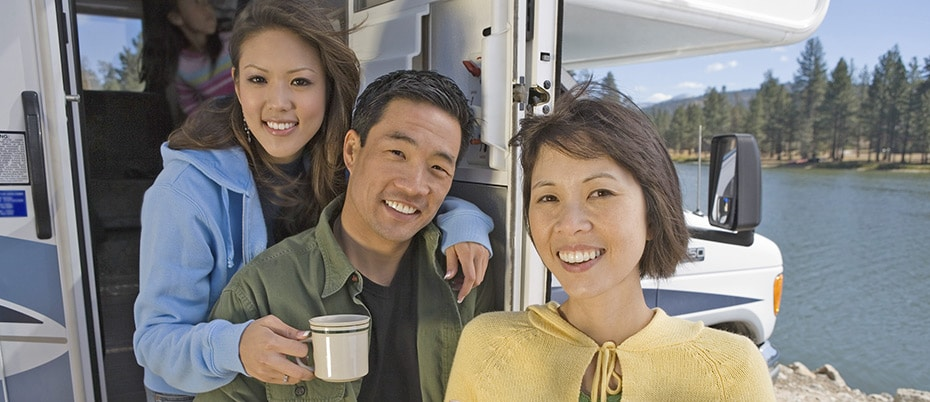 Happy family emerging from RV