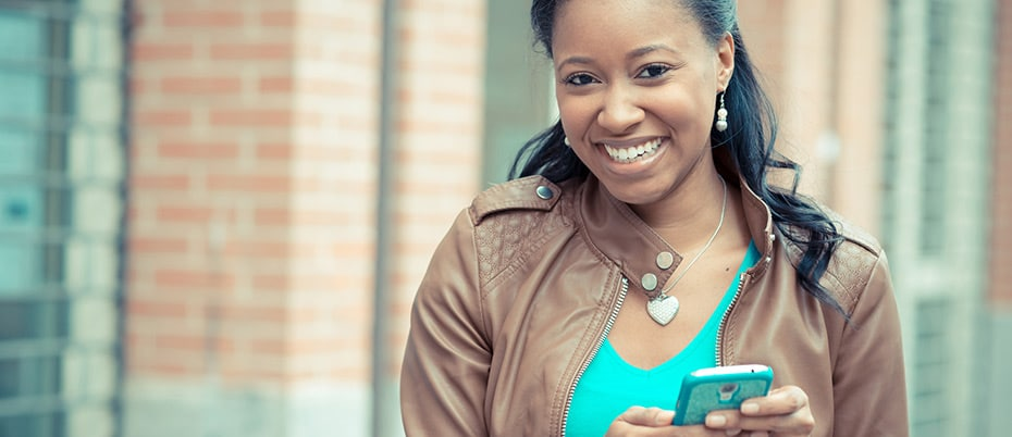 Smiling woman checks her mobile phone
