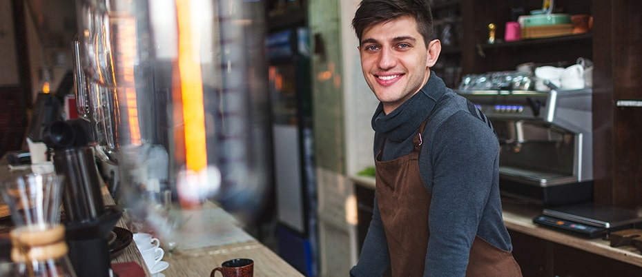 Young man with new job as a barista