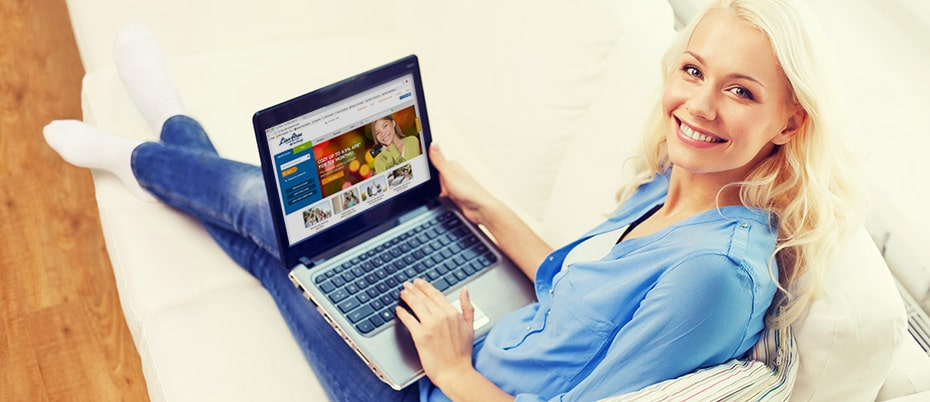 Woman happy to see new LInn Area site on laptop