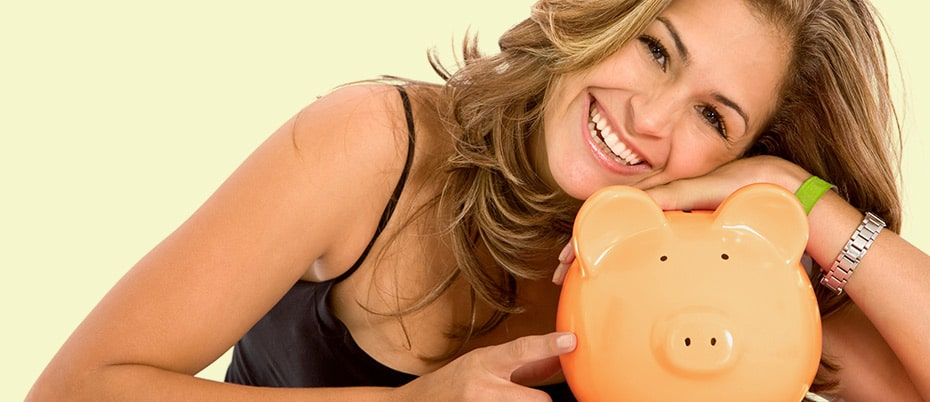 Happy woman with piggy bank