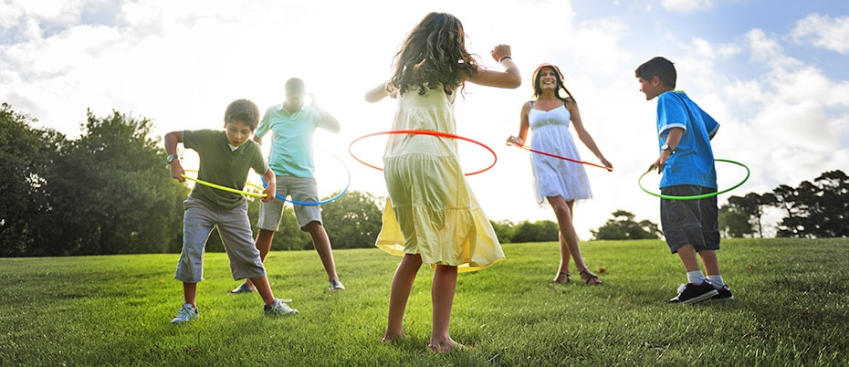 Family outside hula hooping