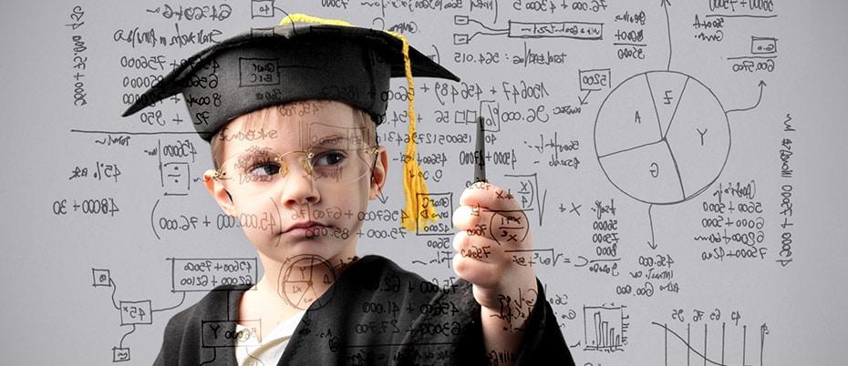 Boy posing as scholarly graduate