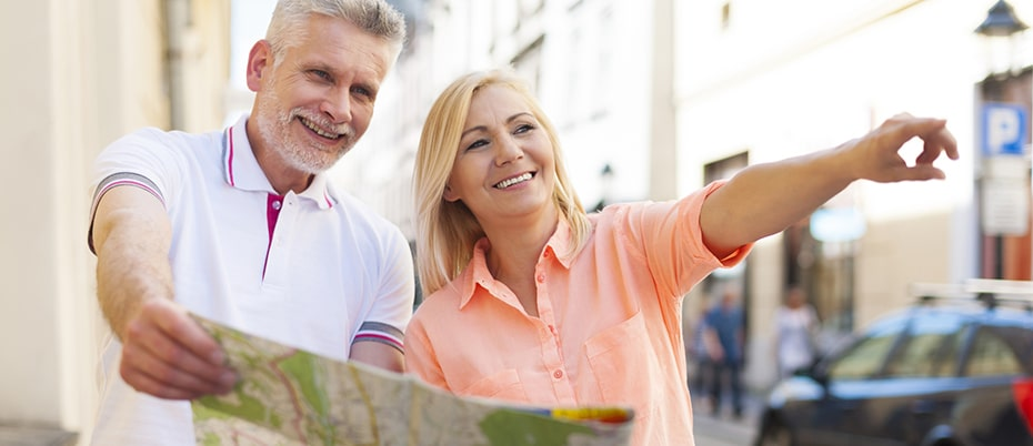 Mature couple traveling with map