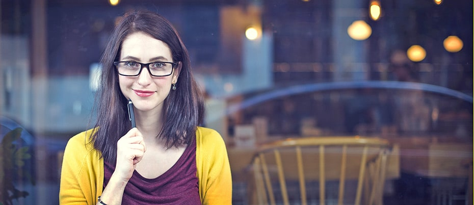 Thoughtful young woman in cafe