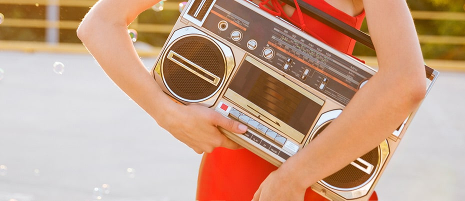 Retro 1980s radio held by girl by road