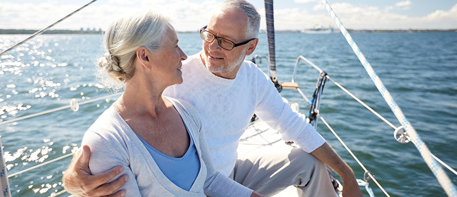 Mature loving couple on sailboat