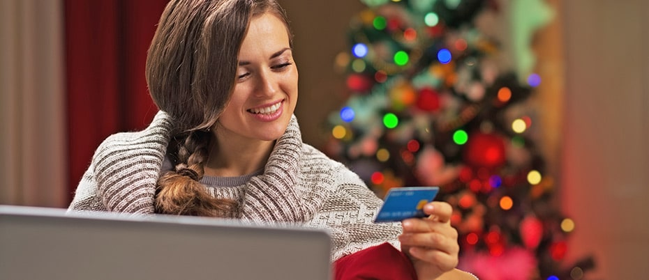 Woman makes online holiday purchase