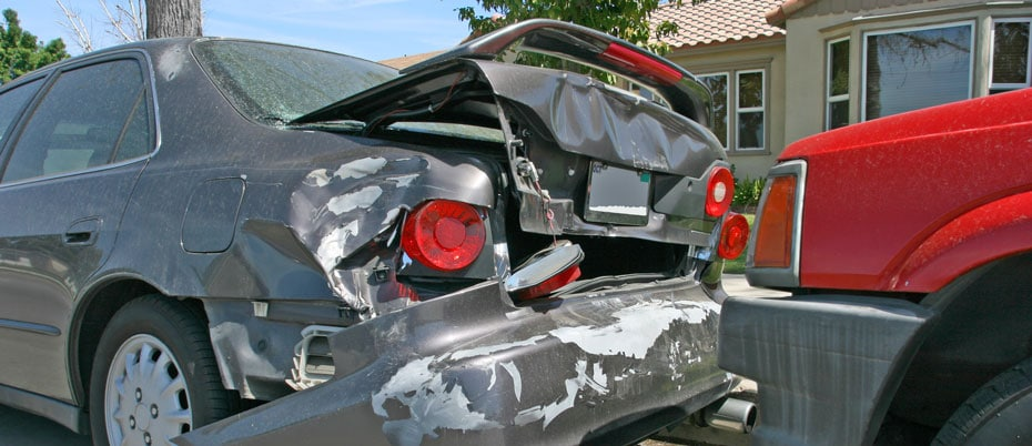 Two-car collision in front of house