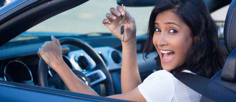 Excited girl holds up car keys