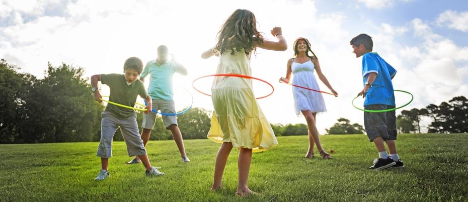 Family of five outside hula hooping