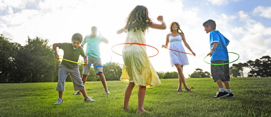 Family of five outside hula hooping
