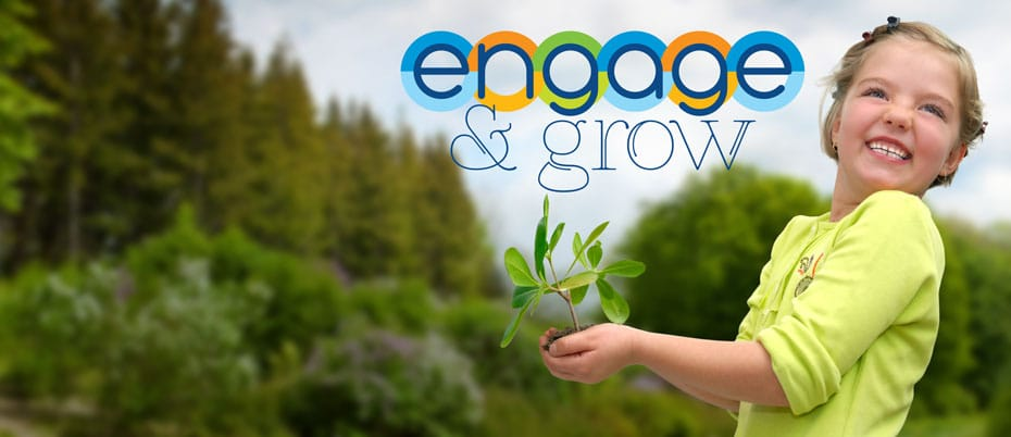 Smiling girl with plant on woodsy background with words engage and grow.