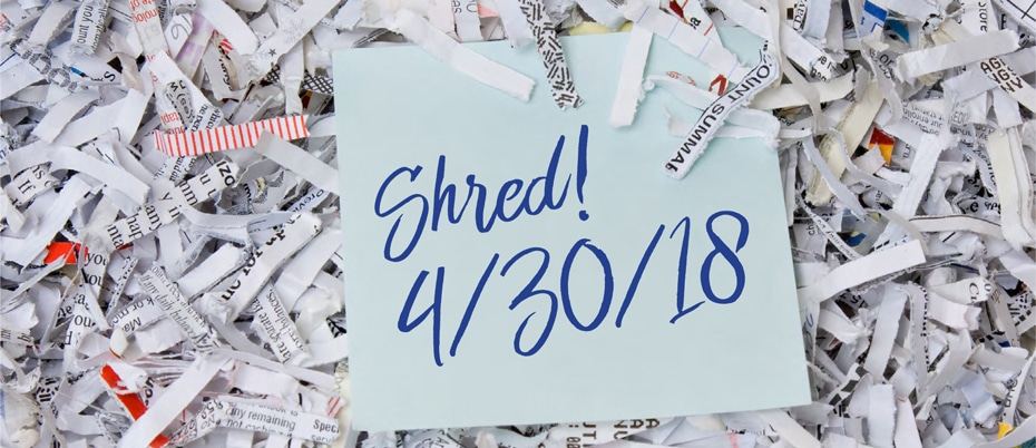 Pile of shredded paper with note on top: Shred! 4/30/18