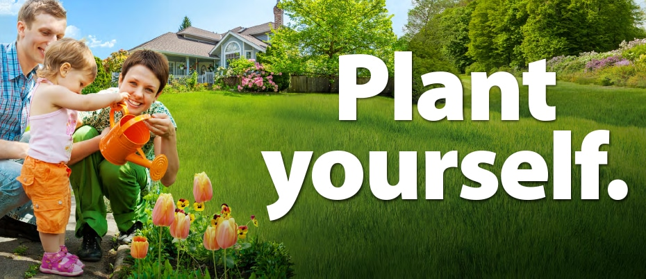 """Young family watering flowers in yard with words """"Plant yourself."""""""
