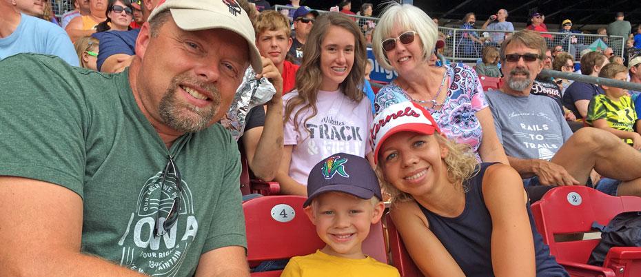 Family in stands enjoying baseball game