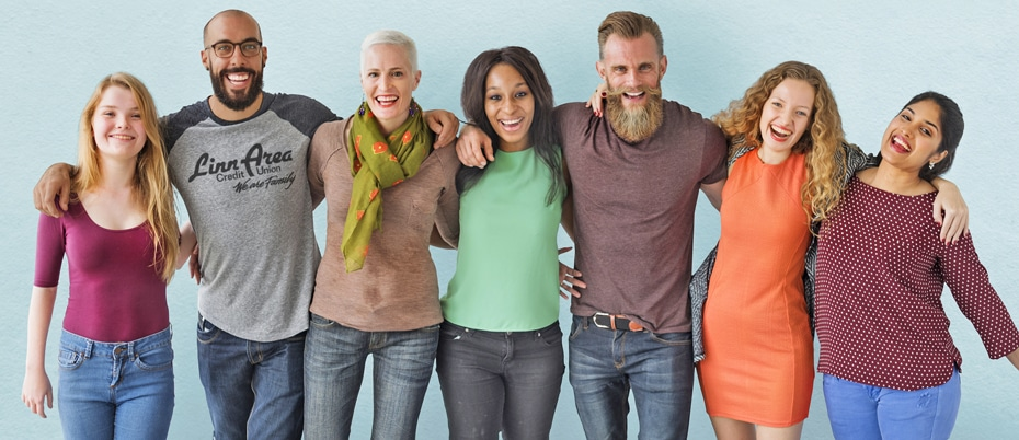 Diverse group of people arm in arm, smiling