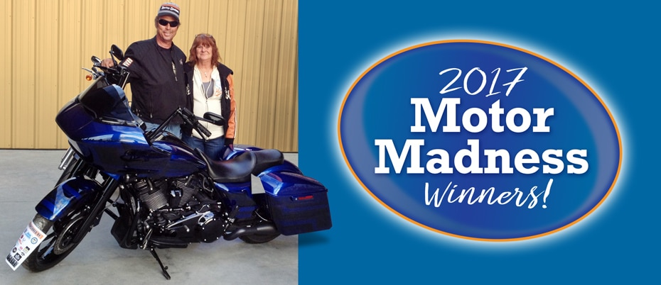 Winners of the 2017 Motor Madness raffle with their new motorcycle