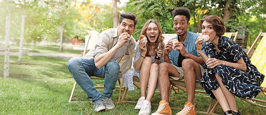 Four friends enjoying a picnic