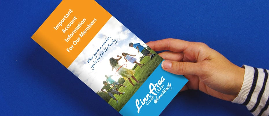 Closeup of hand holding a member information book