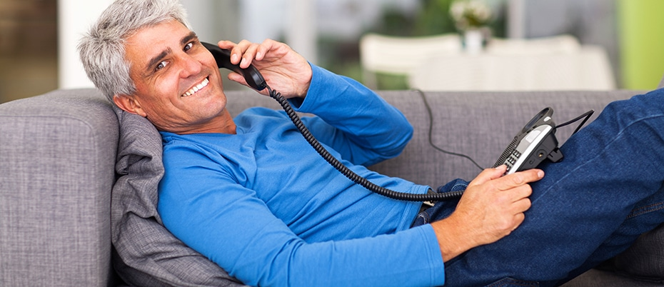 mature man using home phone