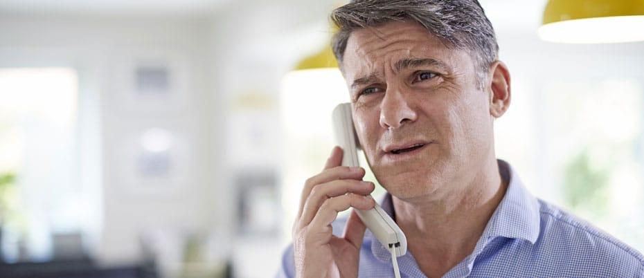 Concerned man on phone