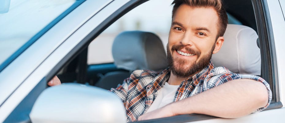Relieved man sitting in his car