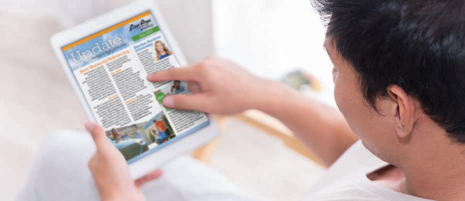 Person reading Linn Area Credit Union newsletter on a tablet